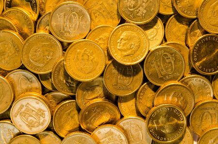 Background of a closeup stack  of golden coins photo