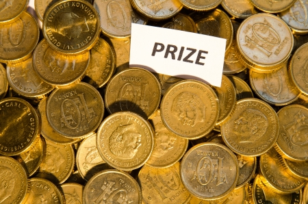 Stack of golden coins with a sign showing Prize photo