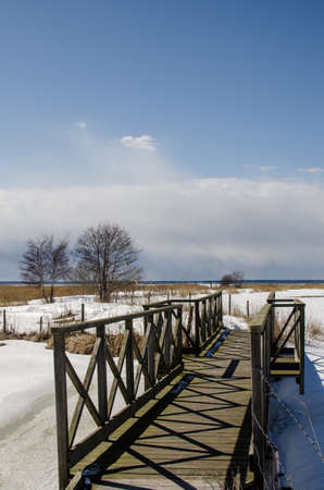 oland: Wooden footbridge at a wetland on the island Oland in Sweden