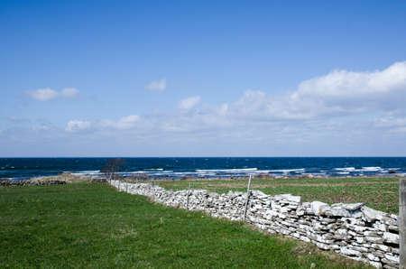 oland: Limestone brick stonewall by the coast of the swedish island Oland in the Baltic sea  Stock Photo