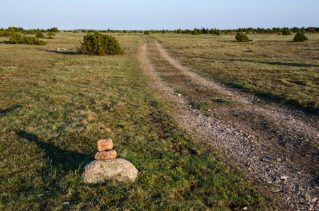Stone marked trail at the Great Alvar Plain at the island Oland in Sweden