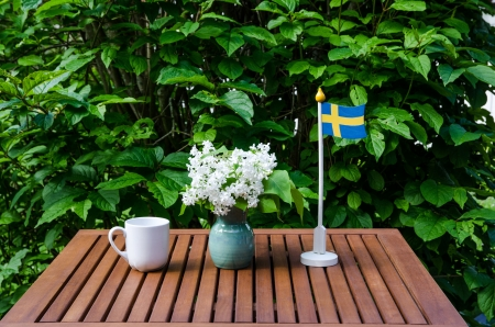 Swedish table decorated with flag, cup and white lilac Stock Photo - 20239492