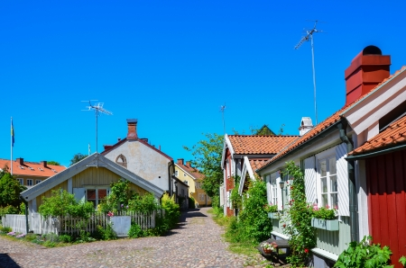 Street view from the old town with small wooden houses in the swedish city of Kalmar by the coast of Baltic Sea