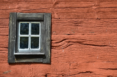 Weathered window at an old wooden red wall Stock Photo - 20926498