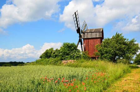 oland: Red old windmill symbol for the island Oland in Sweden Stock Photo
