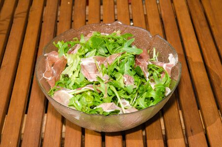 Bowl with fresh salad and ham on a table Stock Photo - 21763734