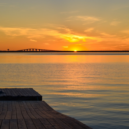 Sunset at the swedish Oland bridge in the Baltic sea Stock Photo