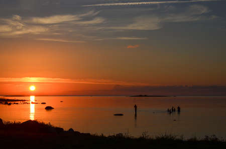 oland: Evening bath at sunset on the island Oland in Sweden Stock Photo
