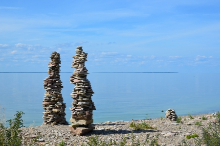 Stonepiles by the coast of the Baltic sea in Sweden photo