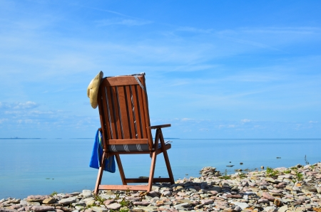 Wooden armchair by the coast photo