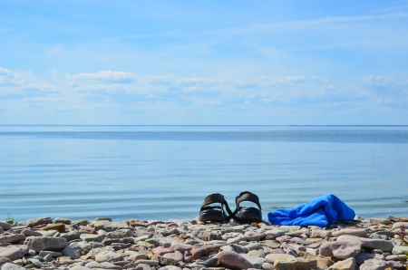 oland: Shoes and towel at the coast of Baltic sea on the island Oland in Sweden