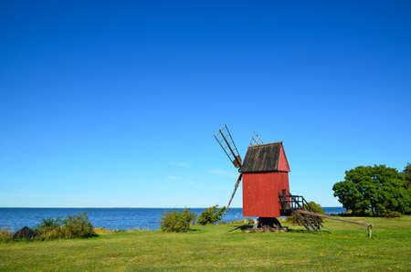 Old windmill by the coast of the island Oland in Sweden photo