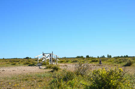 oland: Stile at a footpath in a plain rural area on the island Oland in Sweden Stock Photo