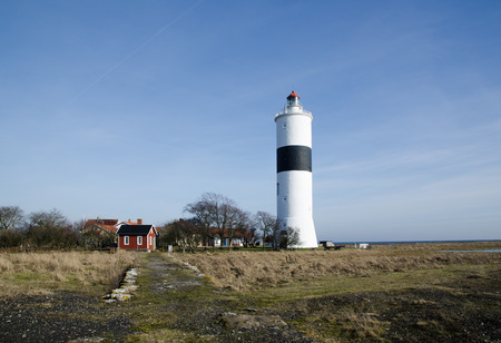 Ottenby lighthouse at the swedish island Oland, an international birdwatching area photo