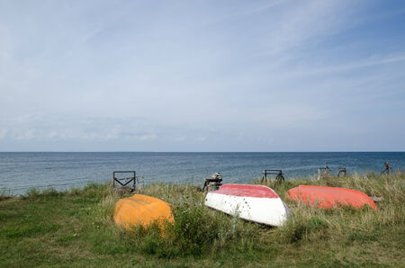 oland: Old rowing boats up side down by the coast of the swedish island Oland in the Baltic Sea Stock Photo