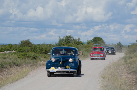 pv: OLAND, SWEDEN August 16, 2014  Volvo PV 60, built at year 1946, in the oldtimer car rally The Swedish Kings Rally at the island Oland in Sweden  This car belongs to The King of Sweden and  the car drives by The King at this image