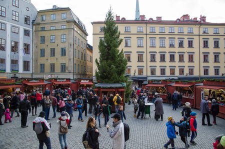 STOCKHOLM, SWEDEN - 28 NOVEMBER: Traditional outdoor Christmas market at Stortorget in the Old Town in Stockholm, the capital of Sweden. Photo is taken on 28 November 2014 at Stortorget, Stockholm, Sweden.