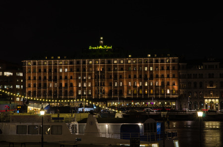 STOCKHOLM, SWEDEN - 30 NOVEMBER: Night view at Christmas decorated Grand Hotel in Stockholm, the capital of Sweden. Grand Hotel is a famous landmark and one of the most luxury hotels in Stockholm. Photo is taken on 30 November 2014 at Skeppsbron, City of