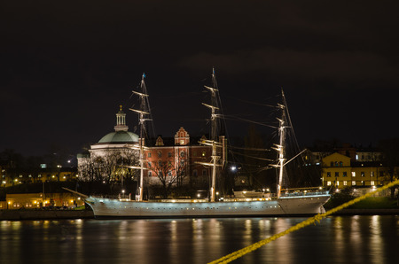 chapman: STOCKHOLM, SWEDEN - 30 NOVEMBER: Night view at the old ship Af Chapman in Stockholm, the capital of Sweden. Af Chapman is a famous landmark in Stockholm and is used as a hostel. Photo is taken on 30 November 2014 at Skeppsbron, City of Stockholm, Sweden. Editorial