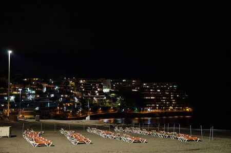 sunbeds: Night view from the beach with sunbeds at the resort San Augustin at Gran Canaria, Spain.