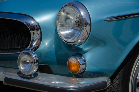 old timer: BORGHOLM, SWEDEN - MAY 23, 2015: Front detail with headlight at a classic car Volvo 1800 ES, 1973, at an old timer car meeting in the town of  Borgholm in Sweden. Ohoto is taken on May 23, 2015, at Borgholm in Sweden. Editorial