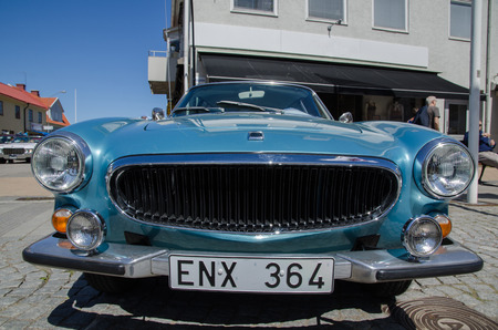 old timer: BORGHOLM SWEDEN  MAY 23 2015: Low angle image of a classic car Volvo 1800 ES 1973 at the old timer car meeting in the town of Borgholm at the island Oland in Sweden.