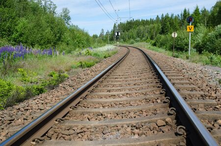 low  angle: Low angle image of railroad tracks in a curve at summer Stock Photo
