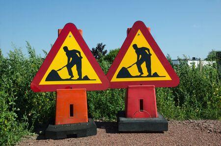 roadwork: Two roadwork traffic signs on the gound Stock Photo