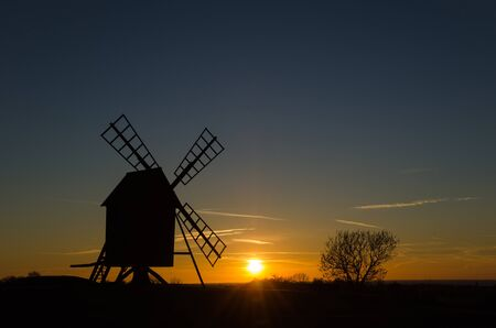 traditional windmill: Sunset with a silhouette of an old traditional windmill at the swedish island Oland
