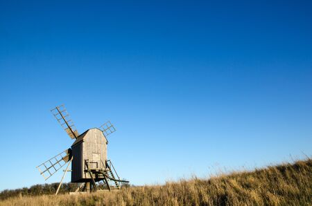 oland: Sunlit old traditional wooden windmill on at the swedish island Oland, the island of sun and wind