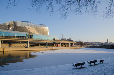 congress center: Stockholm, Sweden - January 7, 2016: View at the Waterfront Congress Center  from a park with benches in Stockholm, the capital of Sweden