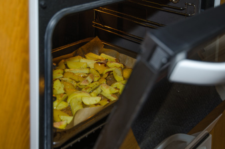 glance: Glance into the oven with sliced roasted potatoes