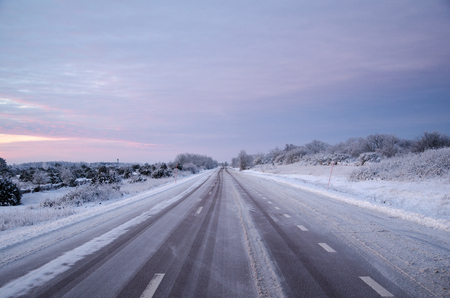 Winter landscape with a snowy asphalt road Stock Photo