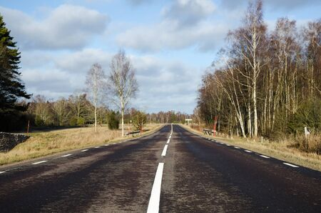 low  angle: Low angle image of a country asphalt road with white stripes Stock Photo