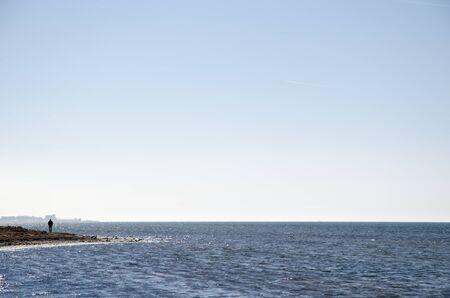 oland: Alone man silhouette by the coastline of the swedish island Oland in the Baltic Sea