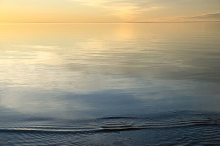 absolute: Absolute calm and smooth water with colorful evening light Stock Photo