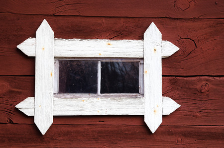 worn structure red: Old white barn window at a red plank wall