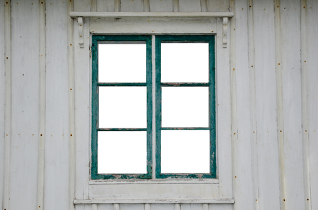 windowpanes: Cut out windowpanes in an old weathered window at a wooden plank facade