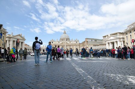 low  angle: Rome, Italy - April 25, 2016: Low angle image of tourists in the Vatican City