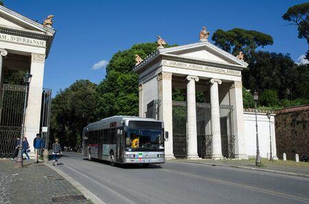 villa borghese: Rome, Italy - April 25, 2016: Bus at the gate to the park Villa Borghese at the street Viale Giorgio Washington in Rome, Italy