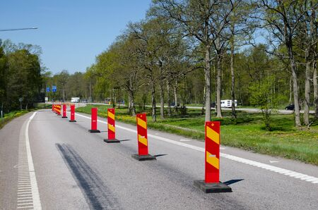 cautionary: Row of colorful roadblocks at the swedish island Oland