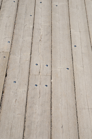 grey nails: Weathered grey wooden plank floor with nails