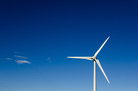 Windmill propeller at a clear blue sky