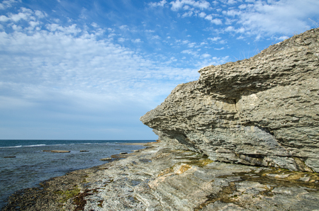 overhang: Eroded limestone cliffs by the coast of the swedish island Oland in the Baltic Sea