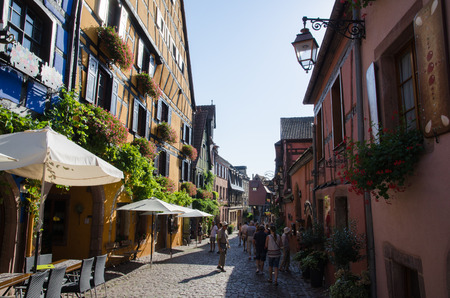 Riquewihr, France - September 13, 2016: The main street Rue du General de Gaulle in the village Riquewihr in Alsace in France, located by the Alsace wine route Editorial
