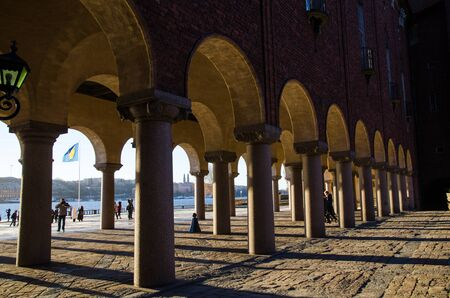 Stockholm, Sweden - December 15, 2016: Columns and shadows at the City Hall in Stockholm, Sweden Editorial