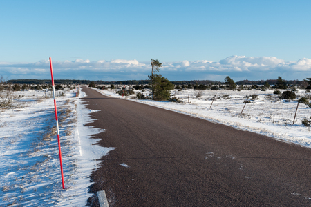 stake: Snow stake by a snowy country road side through the Great Alvar Plain area at the Swedish island Oland