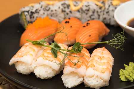 Closeup of a sushi lunch on a black plate Stock Photo