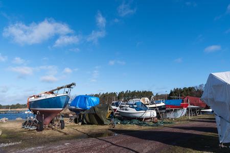 Winter storage of small boats at a boatyard Stock Photo