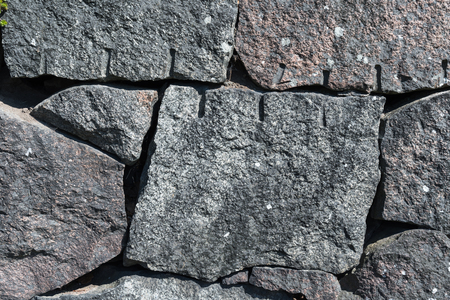 Old granite stone wall background